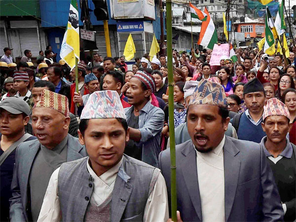 People raise slogans as they participate in a mass rally to demand for separate state of 'Gorkhaland' in Darjeeling. PTI file photo