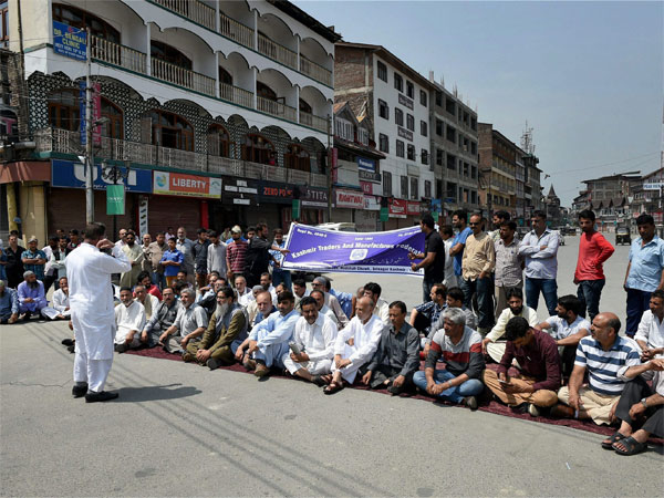 Members of Kashmir Traders and Manufacturers Fedration during a protest against GST at Lal Chowk in Srinagar. (PTI)
