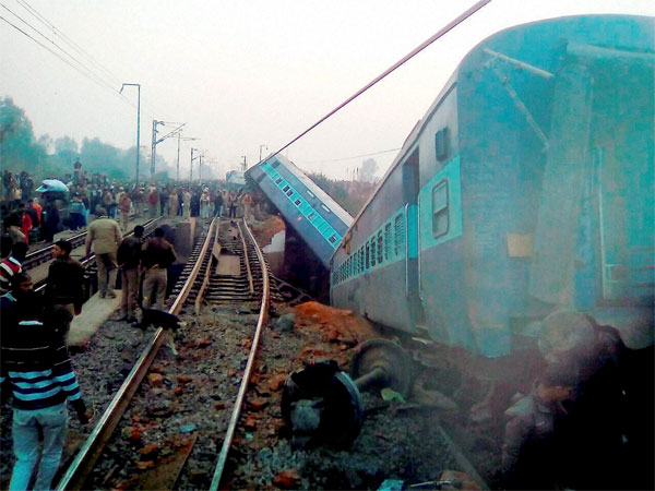 Rescue and relief works in progress at the site of accident where Ajmer-Sealdah express train derailed early morning near Rura railway station in Kanpur dehat district.
