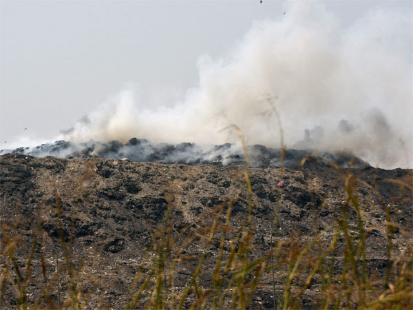 A file photo smoke billowing out of Bhalswa garbage dumping ground near GT Karnal Raod in New Delhi. Photo credit : PTI