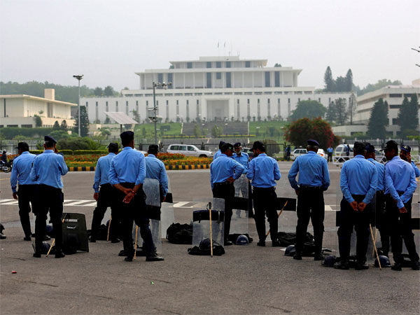 Pakistani security officers stand guard outside the Supreme Court building and Parliament In Islamabad, Pakistan