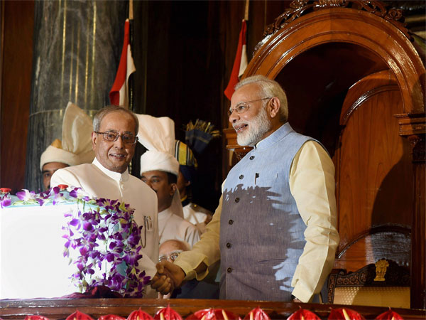 President Pranab Mukherjee and Prime Minister Narendra Modi shake hands after the launch of 'Goods and Services Tax (GST)', at the special ceremony in the Central Hall of Parliament in New Delhi