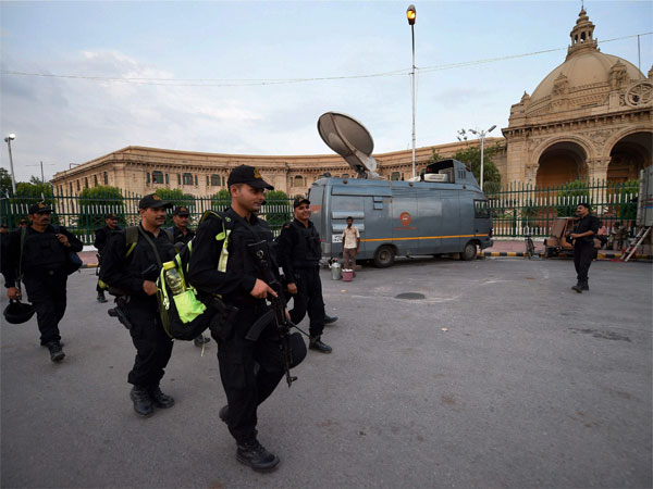 NIA team outside Uttar Pradesh assembly in Lucknow on Friday after PETN explosives were found on the premises. PTI Photo