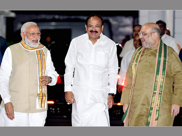 Union Minister M. Venkaiah Naidu with Prime Minister Narendra Modi and BJP President Amit Shah after he was announced as the BJP's Vice-Presidential candidate in New Delhi
