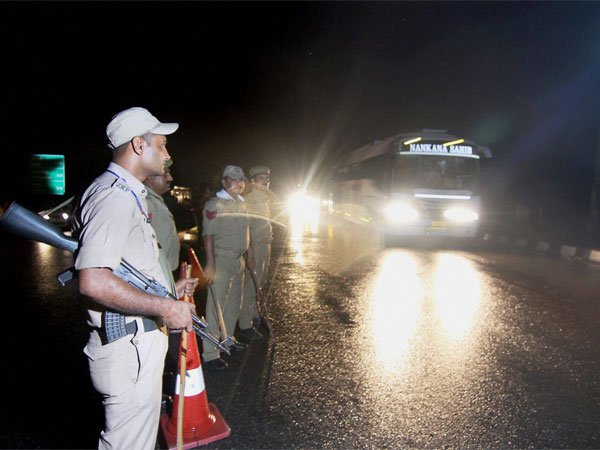 Security personnel keeping a vigil as pilgrims head towards Kashmir to pay obeisance at the Amarnath cave shrine, days after militant attack on pilgrims in Anantnag, in Jammu