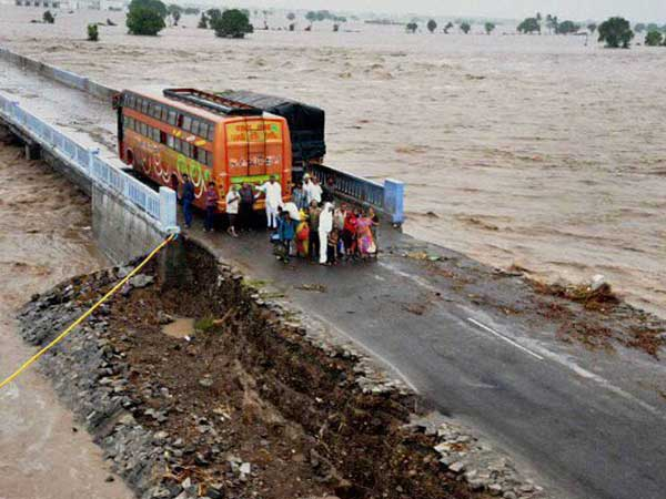 Rescue Teams Airlift, Piggyback, Row People Down In Rain-Ravaged States