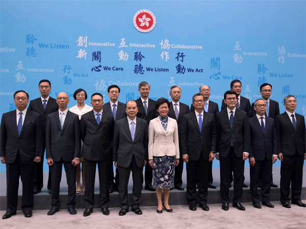 Hong Kong Chief Executive Lam Cheng, (center), lines up with her new members of cabinet during a news conference in Hong Kong. PTI