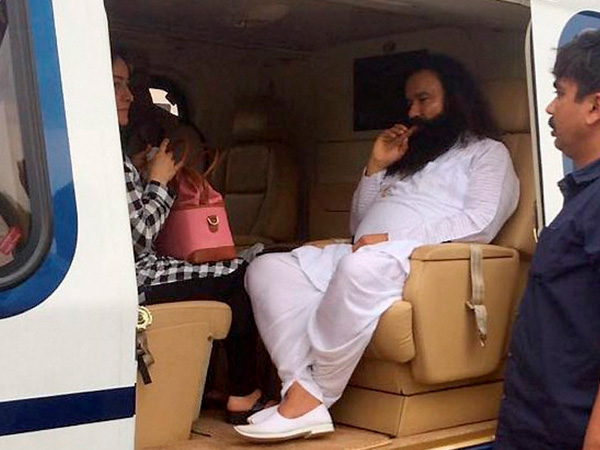 Dera Sacha Sauda chief Gurmeet Ram Rahim in a helicopter in which he was flown from Panchkula to Rohtak town to lodged in jail