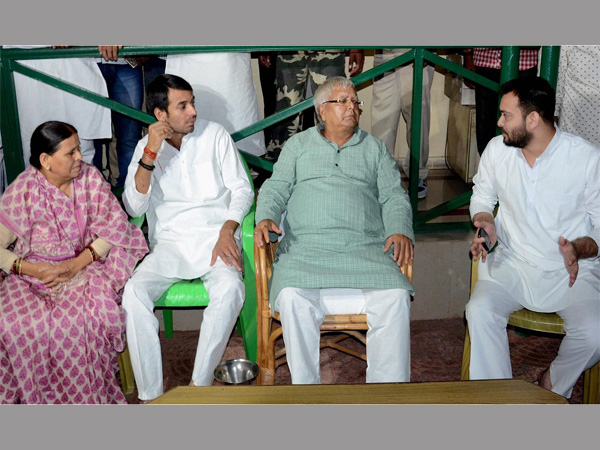 RJD Chief Lalu Prasad with wife Rabri Devi and sons Tej Pratap and Tejashwi Yadav at party lagislators meeting in Patna. PTI file photo