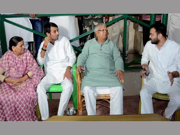 RJD Chief Lalu Prasad with wife Rabri Devi and sons Tej Pratap and Tejashwi Yadav at