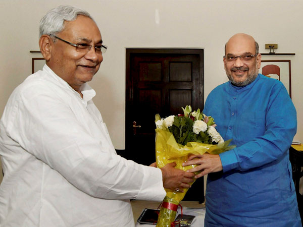 Bihar Chief Minister Nitish Kumar greets BJP President Amit Shah in a meeting at the latter's residence, in New Delhi