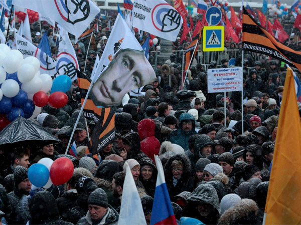 People rally to celebrate the second anniversary of Russia's annexation of Crimea just off Red Square in Moscow, Russia, Friday, March 18, 2016. Russia annexed Crimea in 2014 after a hastily organized referendum not recognized by the United States and the European Union. PTI file photo