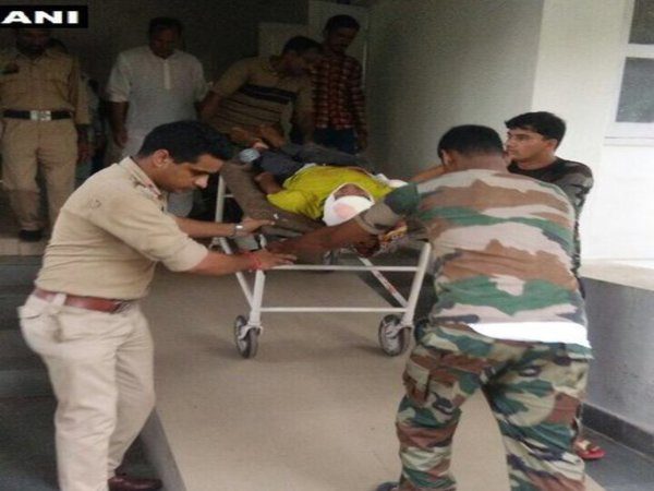 Injured civilian being rushed to hospital