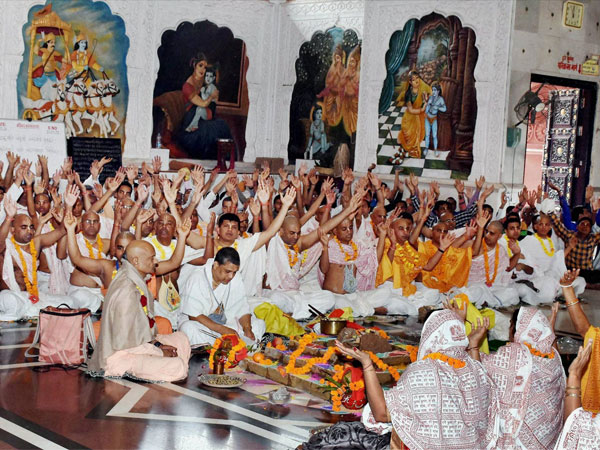 Devotees perform rituals at a ISKCON temple in Surat. PTI file Photo