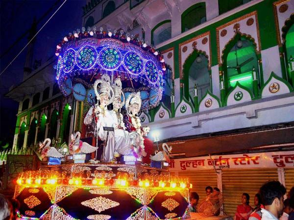 Artists dressed as Lord Rama, Sita and Laksmana during a Dussehra procession