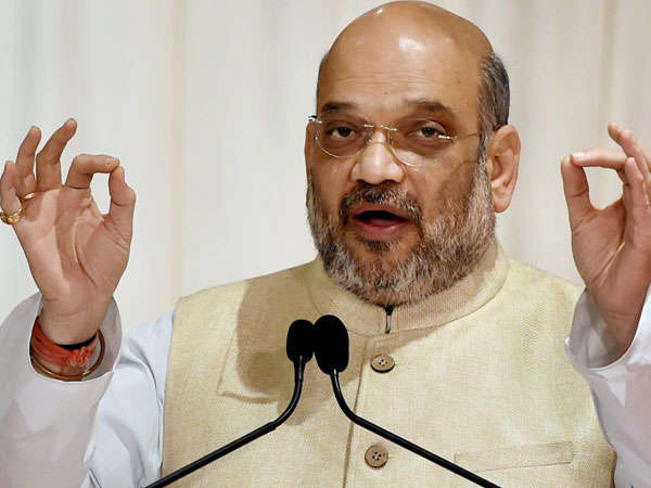 Rahul needs to remove Italian glasses to see development: Shah
