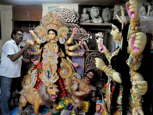 Famous artist Mintu Paul gives final touch to the idols of Goddess Durga, made of fibreglass at Kumartuli in Kolkata