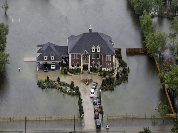 A home is surrounded by floodwaters from Tropical Storm Harvey . PTI file photo