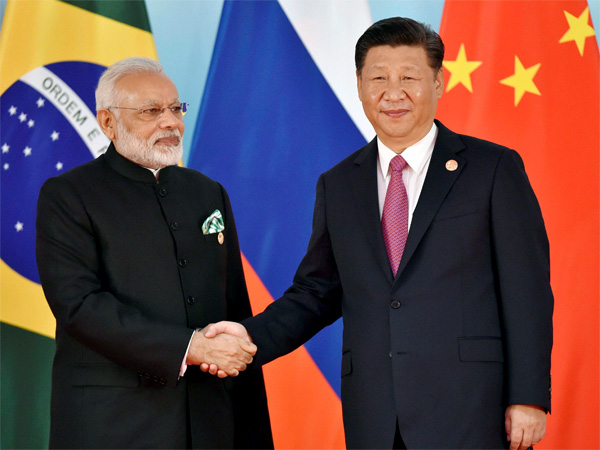 Chinese President Xi Jinping, right, and Indian Prime Minister Narendra Modi shake hands before the group photo session at 2017 BRICS Summit in Xiamen, Fujian province in China