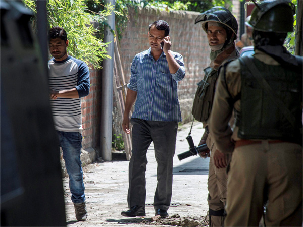 IA officials at a house during a raid in Srinagar on Thursday. NIA today carried out searches at 10 places in Jammu and Kashmir and the NCR in connection with its probe into the funding of terror activities in the Kashmir Valley.