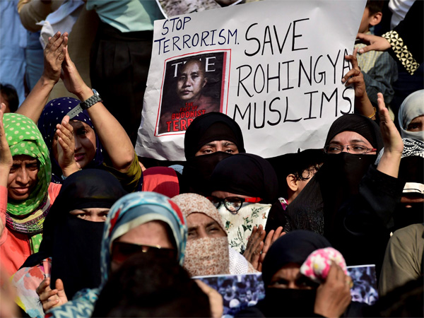 Muslims stage a rally to condemn ongoing violence against the Rohingya Muslims