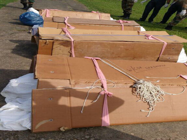 Soldiers' bodies in cardboard boxes
