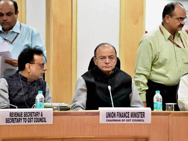 Union Finance Minister Arun Jaitley (C) and Revenue Secretary Hasmukh Adhia (L) at the 22nd meeting of the Goods and Services Tax (GST) council, in New Delhi on Friday. PTI Photo
