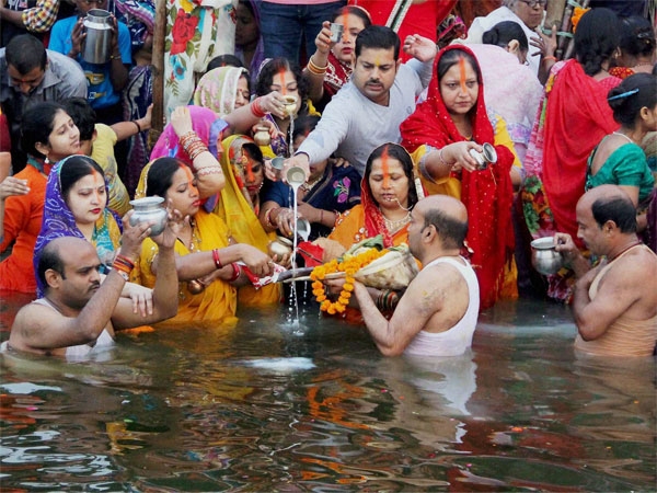 Hindu devotees offer prayers to the rising Sun during Chhath Puja celebrations in Allahabad