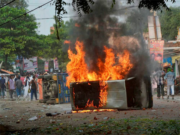 Vehicles set on fire after a clash between two communities during a Muharram procession at Parampurva in Kanpur