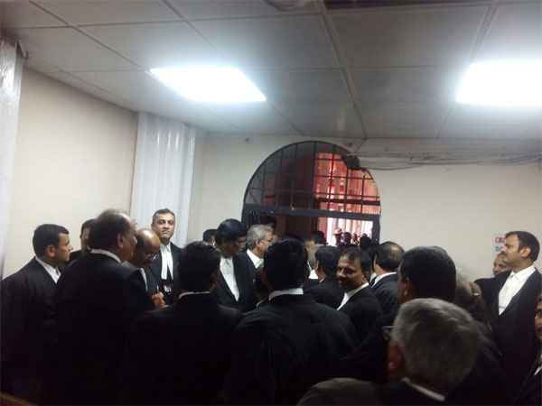 Advocates stage a walkout from court hall no 1 of Karnataka High Court on Tuesday.