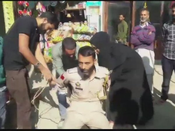 Cop arrested for clicking pictures of woman in Kashmir. Courtesy: ANI news