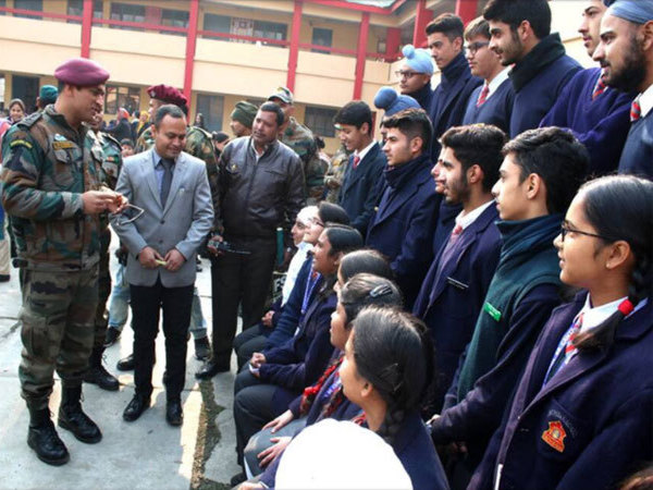 Dhoni interacts with school children
