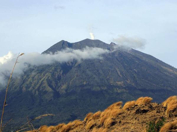 Mount Agung volcano is seen from Kubu village