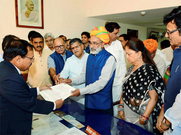Union minister of state for tourism (Independent charges) KJ Alphons file his nomination papers for the Rajya Sabha in Jaipur on Monday. Rajasthan CM Vasundhara Raje is also seen. PTI Photo