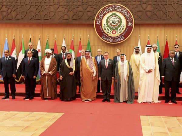 Twenty one kings, presidents and top officials from the Arab League summit pose for a group photo. PTI file photo
