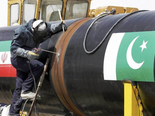 An Iranian worker welds two gas pipes at the beginning of construction of a pipeline to transfer natural gas from Iran to Pakistan, at the mile 250 in southeastern Iran, near the Pakistani border. PTI file photo