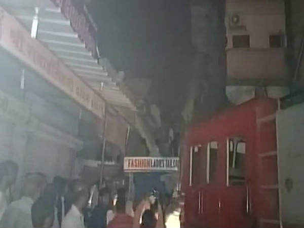 Three-storey building collapses in Vapi. Photo credit: ANI