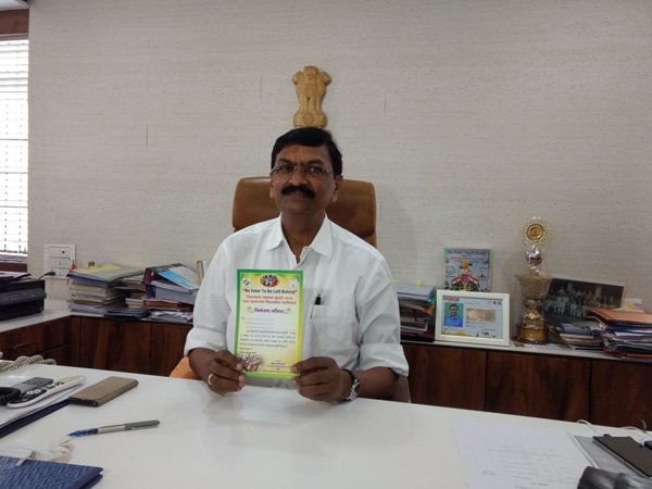 Chief Electoral Officer of Surat with the invitation card (Image courtesy - ANI/Twitter)