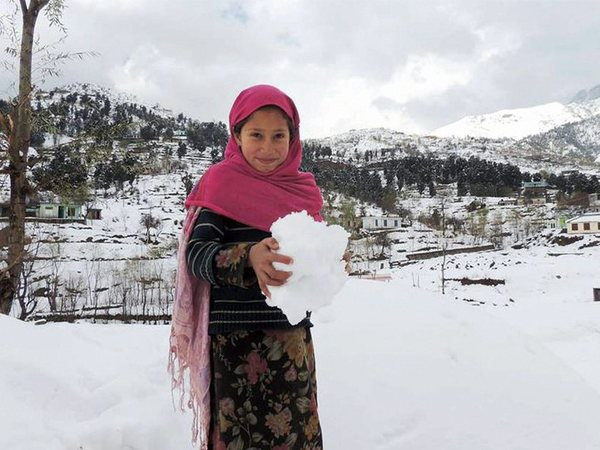 A girl enjoys snow after fresh snowfall in Bafliaz Dera-Ki-Gali in Pir Panchal in Poonch District of Jammu and Kashmir on Saturday PTI Photo