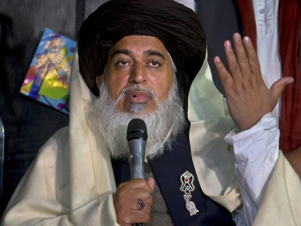 Head of the Pakistani Tehreek-i-Labaik Ya Rasool Allah radical religious party, Khadim Hussain Rizvi gestures during a press conference regarding Saturday's police operation against them, in Islamabad, Pakistan, Sunday, Nov. 26, 2017. Pakistani Islamists pressed ahead with their rally near Islamabad in even larger numbers on Sunday, a day after clashes with police left six dead and dozens wounded. AP/PTI photo