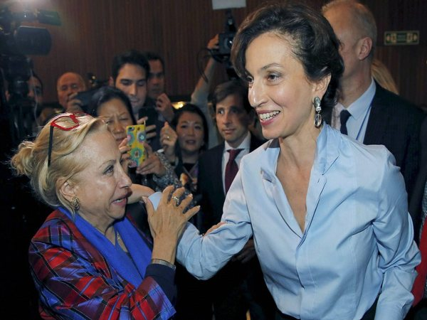 UNESCO'S new elected director-general France's Audrey Azoulay,right, is congratulated by an employee as she arrives at the council hall at the UNESCO headquarters in Paris, France. PTI file photo