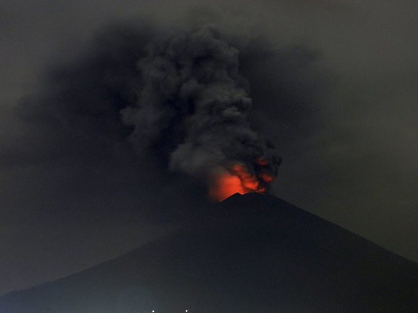 A view of Mount Agung volcano erupting in Karangasem, Bali, Indonesia, Monday, Nov. 27, 2017. Indonesia authorities raised the alert for the rumbling volcano to highest level on Monday and closed the international airport on tourist island of Bali stranding thousands of travelers. AP/PTI photo