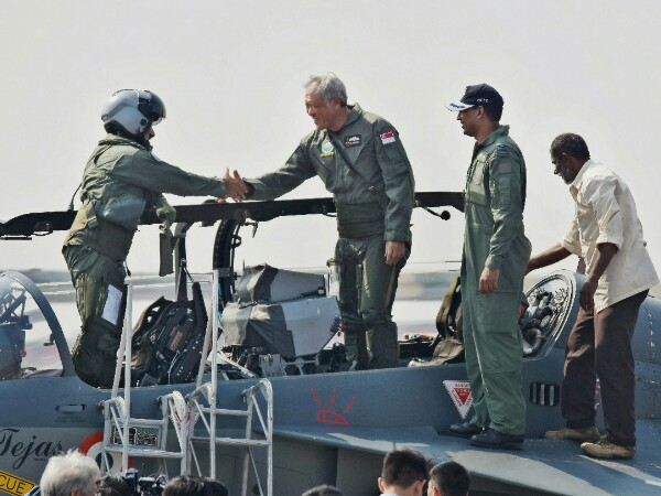 Defence Minister of Singapore, Ng Eng Hen, after a sortie in the trainer version of the Light Combat Aircraft