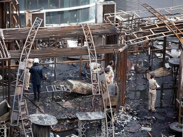 A team of policemen inspecting the fire site