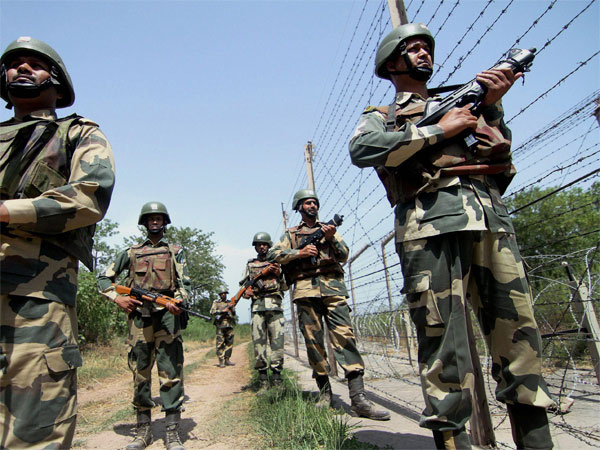 Border Security Force (BSF) personnel patrolling near the International Border following repeated cease fire violations by Pakistan, on the outskirts of Jammu