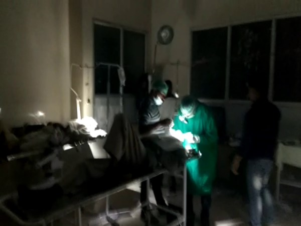 Surgery performed in torchlight