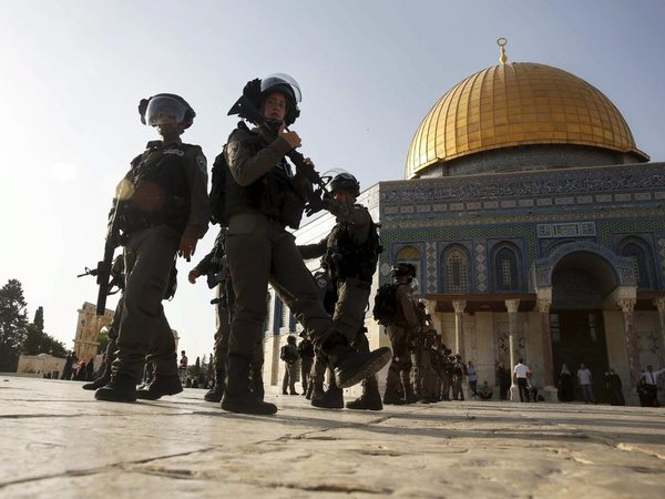 Israeli border police officers stand guard next to the Dome of the Rock mosque at the Al Aqsa Mosque compound in Jerusalem's Old City. PTI file photo
