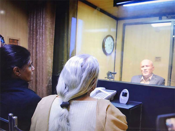 Former Indian Navy officer Kulbhushan Jadhav's wife and mother meet him while seated across a glass partition at the Pakistan Foreign Office in Islamabad