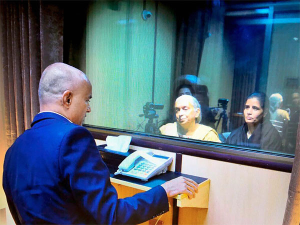 Kulbhushan Jadhav speaking to mother and wife across the glass screen in Islamabad. Courtesy: ANI news