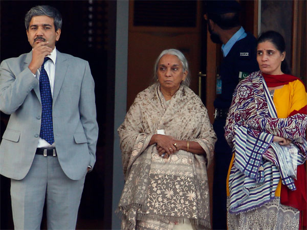 The wife, right, and mother, center, of imprisoned Indian naval officer Kulbhushan Jadhav are escorted by an Indian diplomat after meeting with Jadhav at Foreign Ministry in Islamabad, Pakistan, Monday, Dec. 25, 2017.